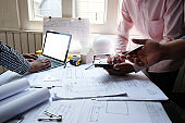 architect engineer team working on house blueprint of real estate project at workplace. construction & building concept