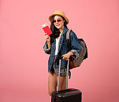 woman backpacker traveler with passport & money. journey trip travel. studio shot