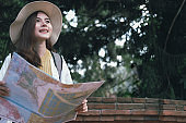 woman traveler tourist with map. journey trip travel concept