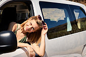 Beautiful blond in car on road trip