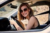 Smiling girl in car