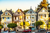 Row of charming colored Victorian style homes on the incline of the hills of San Francisco city, California. Front exterior view of beautiful houses.