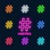 Neon colorful symbols hashtag on a black background.