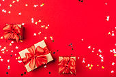 Several gift boxes with bows on a red background.