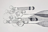 Empty wine glasses and glasses. Abstract shadows, sunlight, white background.