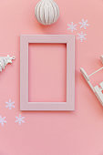 Simply minimal composition winter objects pink frame ornament fir tree sled isolated on pink pastel trendy background