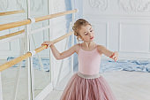 Young ballet dancer in dance class