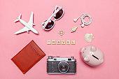 Minimal simple flat lay travel adventure trip concept on pink pastel trendy modern background