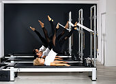 Friends together at Pilates training using Tower Reformer
