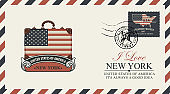 envelope with suitcase, Statue of Liberty and flag