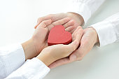 Heart object held by child and mom's hands