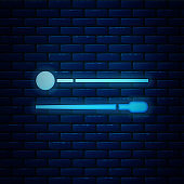 Glowing neon Drum sticks icon isolated on brick wall background. Musical instrument.  Vector Illustration