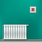 Modern aluminum heating battery hanging on a green blank wall. Housing heating in the winter. Heat saving.