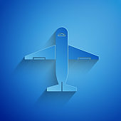 Paper cut Plane icon isolated on blue background. Delivery, transportation. Cargo delivery by air. Airplane with parcels, boxes. Paper art style. Vector Illustration