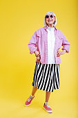 Cheerful retired woman loving bright colors smiling broadly