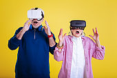 Pensioners feeling excited while wearing virtual reality glasses