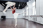 Beautiful young female ballet dancer feeling freedom