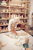 Top view of a skilled grey haired woman working