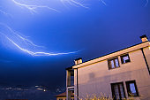 Thunderstorm in the night: Lightning on the sky, neighbourhood, Italy