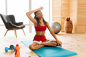 Slim and fit woman feeling tired after intensive active workout