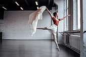 Attractive slim ballet dancer jumping during the dance