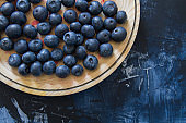 Fresh blueberries in wooden dish