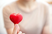 Female hands holding red heart, Love concept for valentines day with sweet and romantic moment, copy space