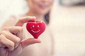 Woman hands hold Smile red heart. Valentine day love, Healthcare and medicine concept, copy space.