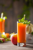Pumpkin, carrot and apple juice in glass