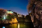 Yongyeon Pond with Yongyeon Pavilion illuminated at night, Jeju islands, South Korea