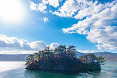 Beautiful autumn foliage scenery landscapes. View from Lake Towada sightseeing Cruise ship