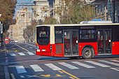 Public transportation / bus in urban surroundings on the street.