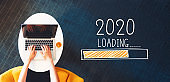 Loading new year 2020 with person using a laptop