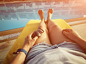 Enjoying summer time vacation near the swimming pool.