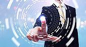 Businessman pushing button on digital screen