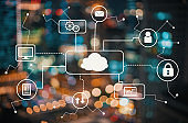 Cloud computing with blurred city lights