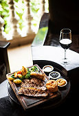 gourmet sunday roast beef traditional british meal set on old wooden pub table