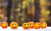 Halloween pumpkin decorations on a forest background