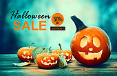 Halloween sale with pumpkins at night