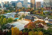Deoksugung Palace and Seoul city in autumn season in Seoul, South Korea.