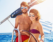Happy couple on a sailboat