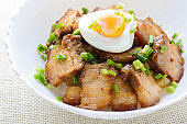 "Bowl of rice topped with Braised pork belly and boiled egg, Japanese called Kakuni-don""n"