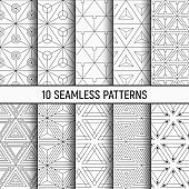 Set of ten monochrome seamless patterns of triangles. Abstract geometrical trendy vector backgrounds. Linear style.