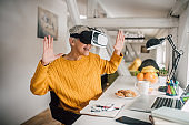 Woman wearing virtual reality and smiling