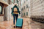 Girl walking with her luggage
