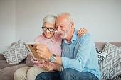 Older couple with a photograph