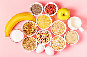 Ingredients for healthy breakfast - cereals, grains, dairy products, seeds, nuts and fruits