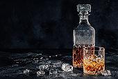 Whiskey on a stone dark background