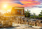 Fresco with bull and three columns in Palace Knossos under sunset, Crete island, Greece