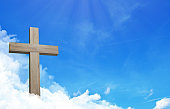 The cross of jesus and cloudful blue sky with copy space